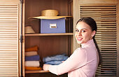 Spring cleaning of closet. Young woman by the retro style storage