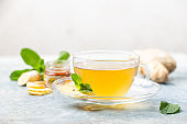 Ginger tea in a glass cup