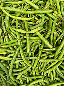 French beans, string beans, snap beans stacked up in a street market