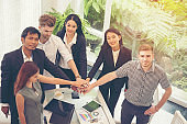 Business Partners Trust in Team with hands together to Greeting Start up project Contractor. Businessman Teamwork are Partnership in Office of Team Meeting room. Business Conference Concept