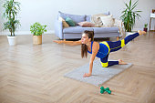 Health care concept - pregnant young woman doing exercises on the floor