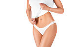 Slim tanned woman's body. Woman showing her waist. Isolated over white background