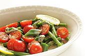 Homemade cherry tomato and Okra with sesame dressing salad