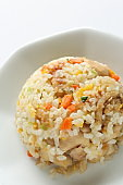 Chinese food, chicken and carrot fried rice on white plate
