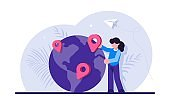 Concept of geographic location, world navigation, choice of travel destination, trip or journey planning. Woman standing beside globe with map pins on it. Modern flat vector illustration.