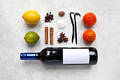 Mulled wine ingredients flat lay composition on a light textured background