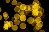 Blurred christmas lights on on dark background as a symbol of Christmas or New Year mystery and magic. Christmas background.