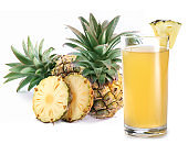 Glass of pineapple juice and group of pineapple fruits at the background. Studio shot isolated on white background.