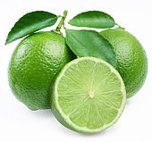 Lime citrus fruit with a slice of lime and leaves isolated on a white background.