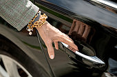 Hand of contemporary mature elegant businesswoman or agent with bracelets