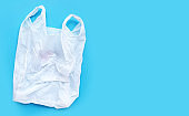 White plastic bag on blue background.