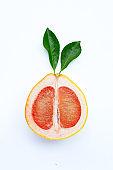 High vitamin C. Juicy grapefruit slices on white.