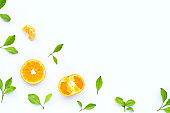Fresh orange citrus fruit with leaves on white background. Juicy, sweet and high vitamin C.