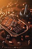 Still life of hazelnut and milk chocolate