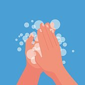 Wash hands. Man holding soap in hand in soap bubbles