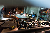Young male mechanic works in his home workshop