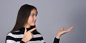 woman pointing to empty place on hand