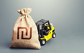 Yellow forklift unable to lift a israeli shekel money bag. Strongest financial assistance, support of business and people. Helicopter money, subsidies soft loans. Interest rate. Stimulating economy.