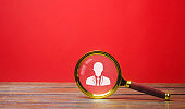 Magnifying glass and worker symbol. Recruitment concept. Hiring, hire. Human Resource Management. The concept of the search for people and employees. Employment