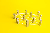 People connected by lines on a yellow background. Self-organized hierarchical business company system. Distribution responsibilities tasks between workers. High autonomy. Social management strategies