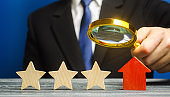 A critic rates a hotel rating. Three stars. The evaluation of visitors. Quality level, good service. Customer rating. Feedback.