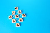 Connected people blocks on blue background. Concept of order, orderliness and uniform structure. Team building. Employee network. Human resource management, hiring and staffing. management strategies