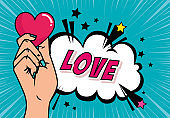 hand and heart with love lettering pop art style