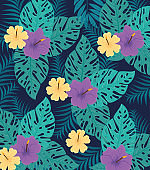 tropical background, flowers purple and yellow colors with tropical plants, decoration with flowers and tropical leaves