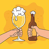 hands holding beers in cup and bottle, on yellow background