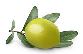 Close-up of green olive with olive branch on white