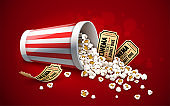 Popcorn in paper bucket. Full cup and gold cinema tickets. Illustration.