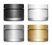Collection of cosmetic cream jars on white