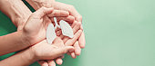Adult and child hands holding lung, world tuberculosis day, world no tobacco day, corona covid-19 virus, eco air pollution; organ donation concept