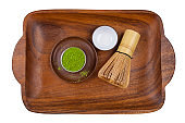 Matcha tea and leaves with tea whisk