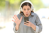 Amazed woman finding music on smart phone