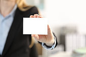 Executive hand showing blank business card