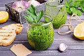 Green sauce in a glass jar