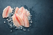 Fresh fish fillet of sea bass in ice.