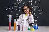 funny scientist child in lab coat having an idea