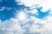 Sunlight and clouds with blue sky background