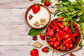 Ingredients for cooking strawberry jam. Ripe berries, brown sugar, fresh mint, fragrant spices