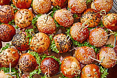 burgers, buns with sesame seeds, with salad, vegetables, top view