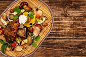 Fresh forest mushrooms. Assorted gourmet porcini and boletus, oak leaves
