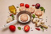 Raw cutlets, fresh vegetables, spices, olive oil. Vintage pan, picnic or barbecue cooking concept