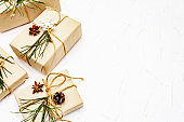 Zero waste gift concept. Christmas or New Year decor from pine branches and cones, star anise and vintage thread. Plastic-free recyclable lifestyle