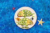 Funny salmon sandwiches with cucumber for kids