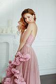 Woman model dressed in a elegant evening classic dress