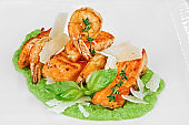 Grilled salmon fish steak and fried shrimps on green puree