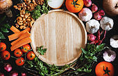Wooden dish surrounding with fresh healthy food ingredient