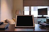 Digital tablet, blank black screen on working table
